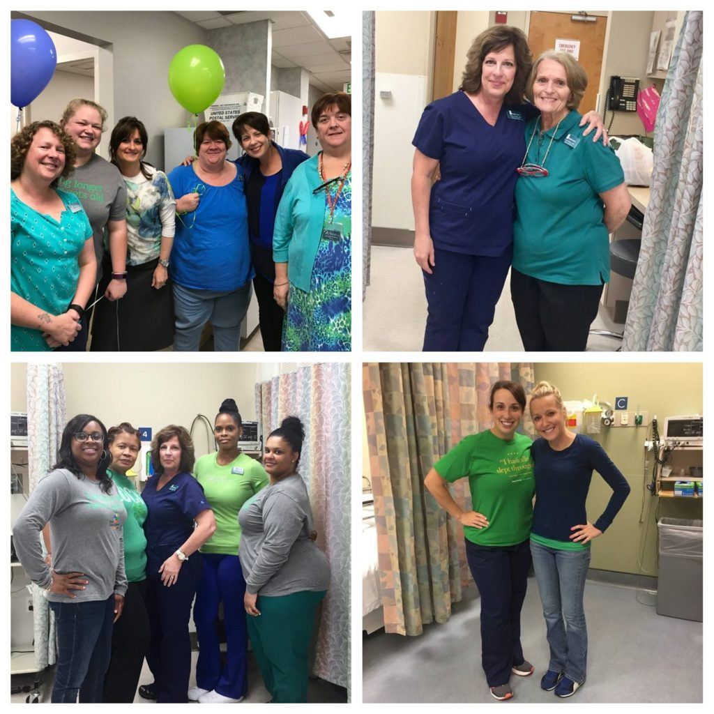 medical staff in green and blue scrubs smiling